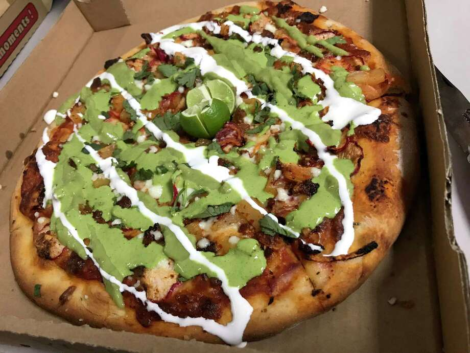 The Famous Al Pastor pizza from Hungry Chameleon Pizzeria, which is located at 1053 Austin Highway. Photo: Paul Stephen / Staff