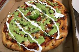 The Famous Al Pastor pizza from Hungry Chameleon Pizzeria, which is located at 1053 Austin Highway.
