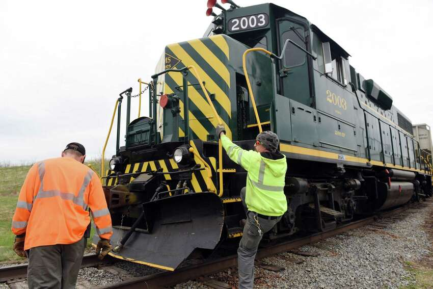 Locomotive Engineer Chad Henry, right, and conductor Everett Scully climb onto the locomotive engine on Wednesday, May 1, 2019 at the former PCB processing plant in Fort Edward, NY. (Phoebe Sheehan/Times Union)