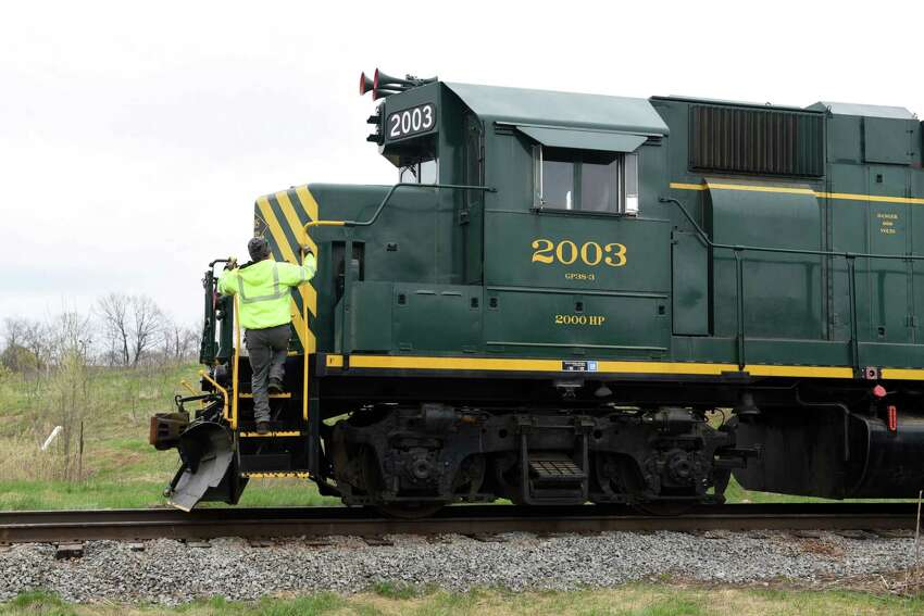 Locomotive Engineer Chad Henry climbs onto the locomotive engine on Wednesday, May 1, 2019 at the former PCB processing plant in Fort Edward, NY. (Phoebe Sheehan/Times Union)