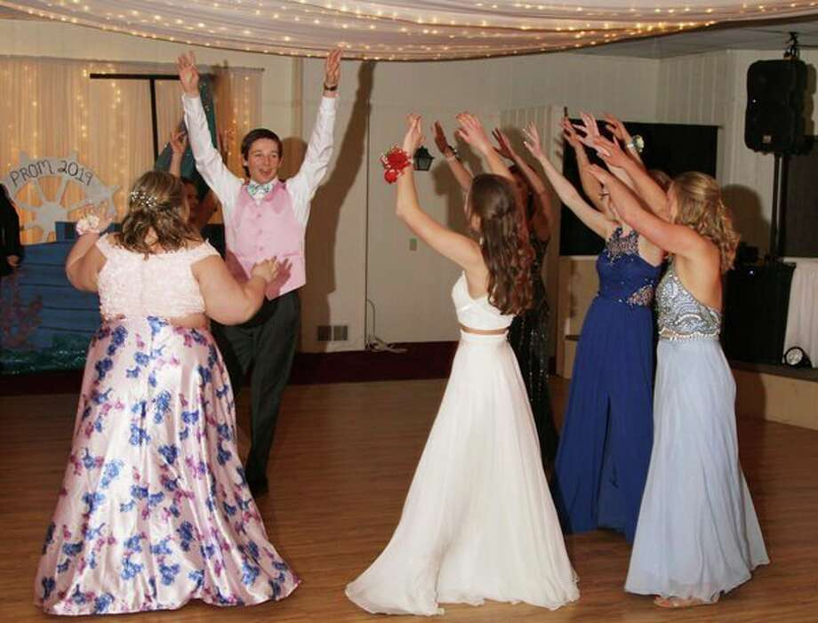 Cass City junior Kendall Anthes (center) got the dancing going Saturday night -- with some dance moves of his own -- at Cass City's prom celebration. For more photos of the night, see Page 8A. (Coulter Mitchell/For the Tribune)