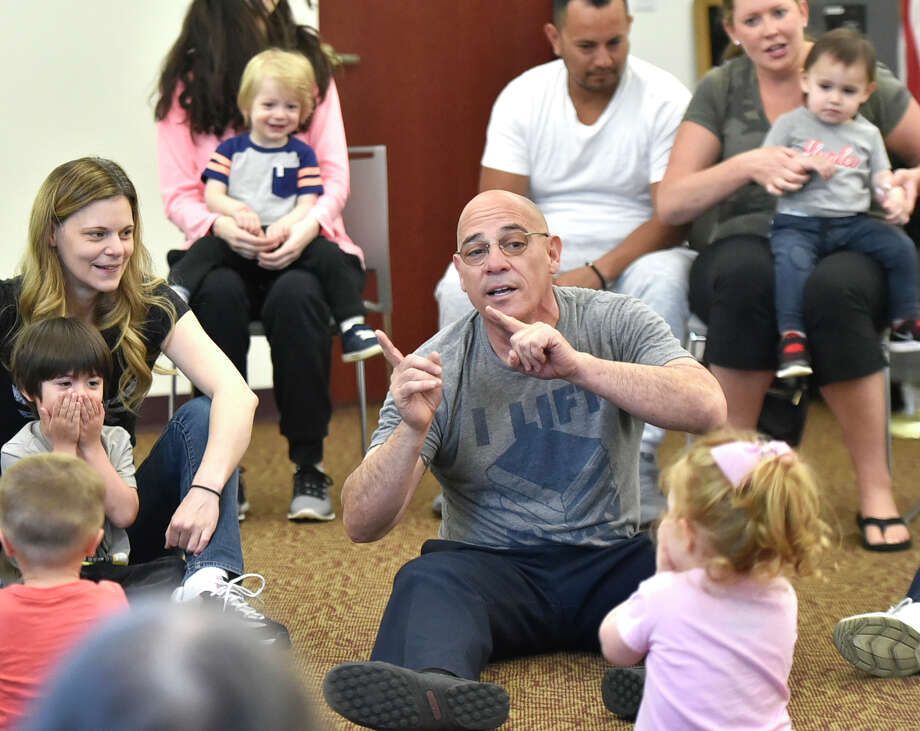 """North Haven, Connecticut - Wednesday,  May 8, 2019: Librarian Joe """"Coach Joe"""" DeFrancesco leads the """"Kids Rock"""" program Wednesday morning for children 6-months to 5 and their parents engaging them in music, movement, songs, and children's book stories at the North Haven Memorial Library. Photo: Peter Hvizdak, Hearst Connecticut Media / New Haven Register"""