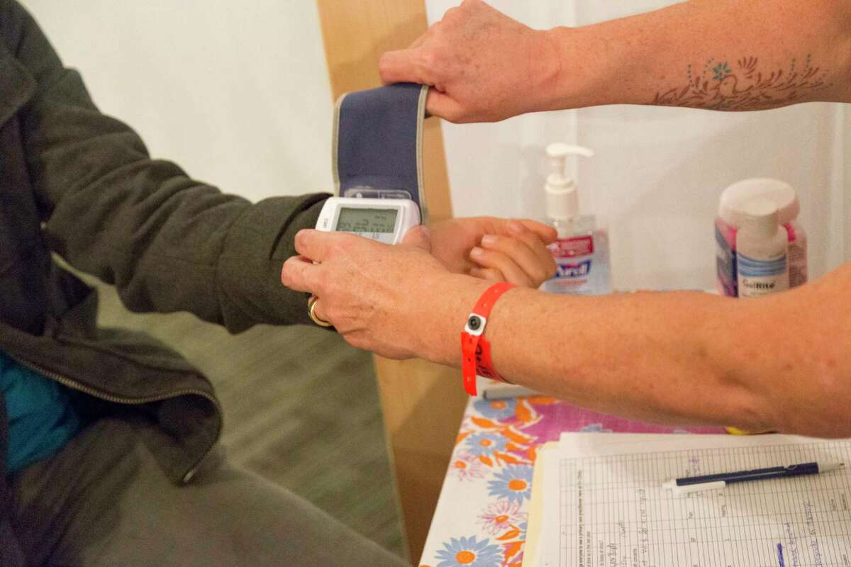 Clincians at a previous O+ Festival provide health checks at the event. (Stefan Lisowski)