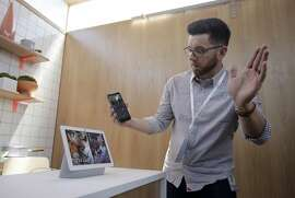 Google's Alexander Hunter gives a demonstration of the Nest Hub Max at the Google I/O conference in Mountain View, Calif., Tuesday, May 7, 2019. (AP Photo/Jeff Chiu)