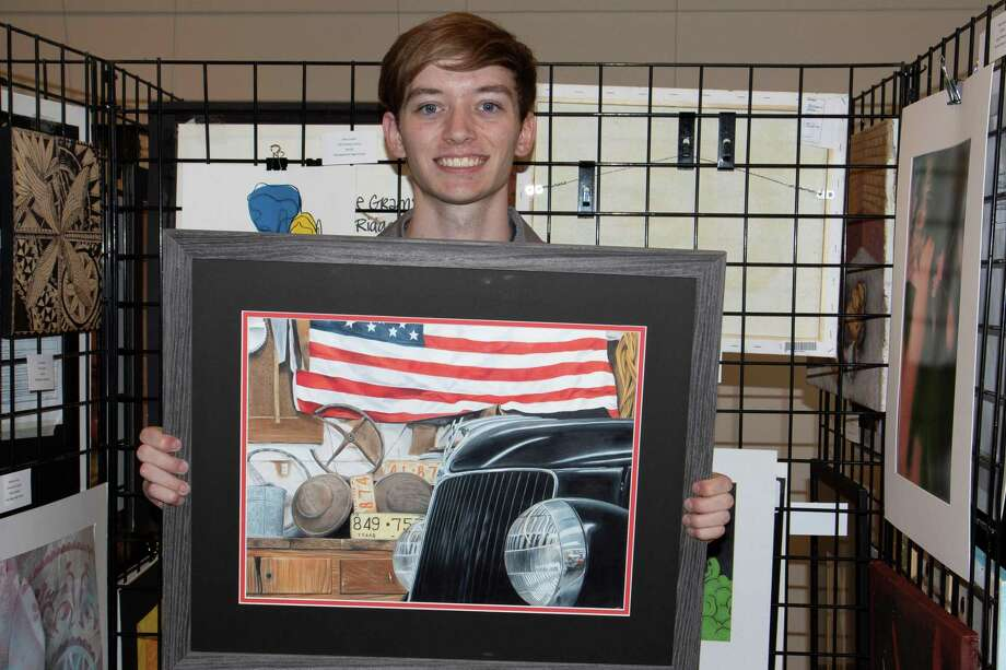 "Jake Hall, a senior at Magnolia West High School, holding his colored pencil painting titled ""PaPa's Ford,"" which won Best of Show at the Conroe Art League's 2019 Student Scholarship competition, held on May 4. Photo: Photo By Linda Duffy, Photographer / © 2018 Linda Duffy"