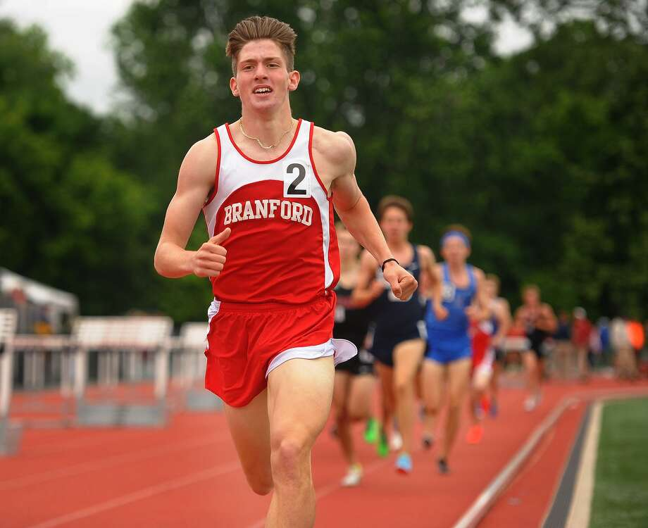 Branford's Marzio Mastroianni leads on the third lap of the boys 1600 meters at the CIAC Track & Field Championships in New Britain, Conn. on Monday, June 4, 2018. Photo: Brian A. Pounds / Hearst Connecticut Media / Connecticut Post