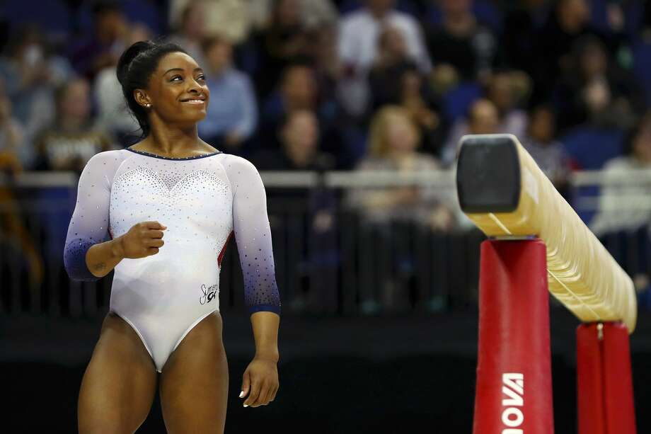 PHOTOS: Previous covers of Sports Illustrated's Swimsuit Issue  Simone Biles, shown here at the Superstars of Gymnastics event in London on March 23, 2019, will appear in this year's Sports Illustrated Swimsuit Issue. She also was featured in the 2017 issue.  Browse through the photos above for a look at previous Sports Illustrated Swimsuit Issue covers ... Photo: Naomi Baker/Getty Images