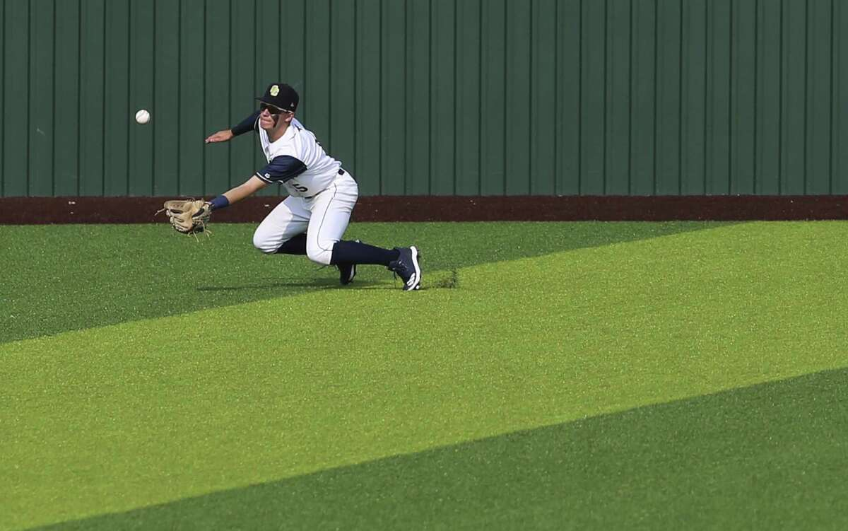 O'Connor 's Kevin Potts (05) makes a tricky catch in center field against Reagan in Game 2 of their best-of-3 first-round baseball playoff series at North East Sports Park on Friday, May 3, 2019. Reagan defeated O'Connor, 10-4, to move on to the next round of the playoffs. (Kin Man Hui/San Antonio Express-News)