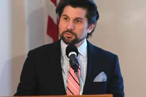 """Jim Malatras, president of the Rockefeller Institute of Government, welcomes listeners and speakers to the institute for a forum """"Does Repeal and Replace Equal Improve and Access? The Effect of the AHCA on New York"""" on Friday, March 24, 2017 in Albany, N.Y."""