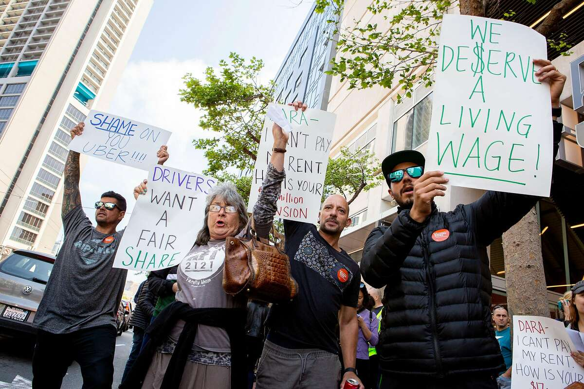 From left: Marcos, Alison Datz, Rafael and Vinicius protest outside Uber headquarters on Wednesday, May 8, 2019, in San Francisco, Calif. The men respectfully declined to give their last name.