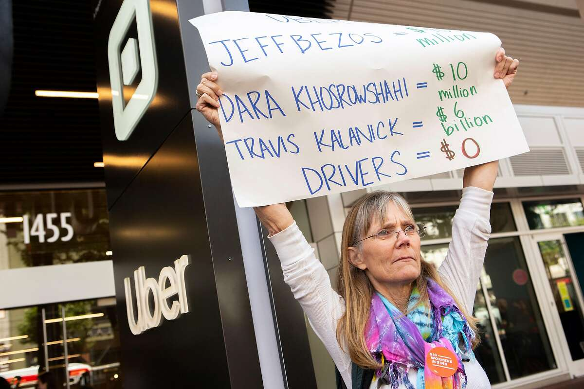 Ann Glatt, a Lyft driver from Sacramento, protests outside Uber headquarters on Wednesday, May 8, 2019, in San Francisco, Calif.