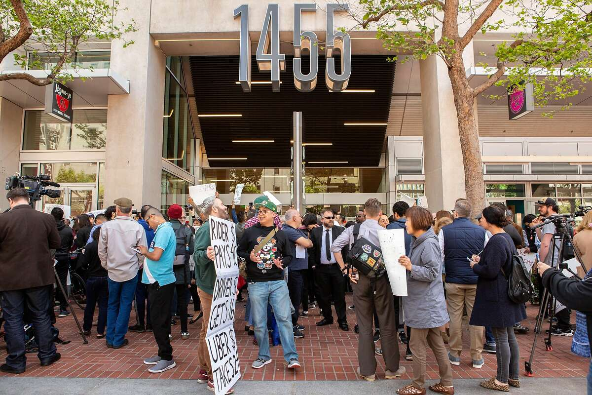 People protest outside Uber headquarters on Wednesday, May 8, 2019, in San Francisco, Calif.