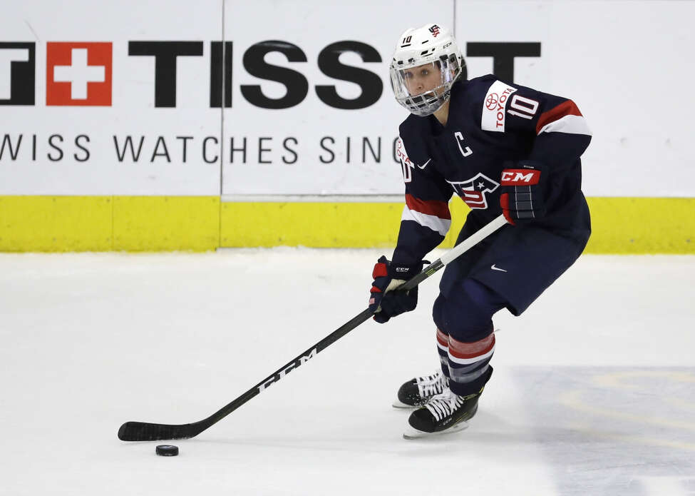 United States forward Meghan Duggan in 2017 controls the puck during the first period of a IIHF Women's World Championship semifinal hockey tournament game against Germany in Plymouth, Mich. More than 200 of the world's top female players are choosing not to play professional hockey in North America at all this year in an attempt to establish a economically viable professional league. (AP Photo/Carlos Osorio, File)