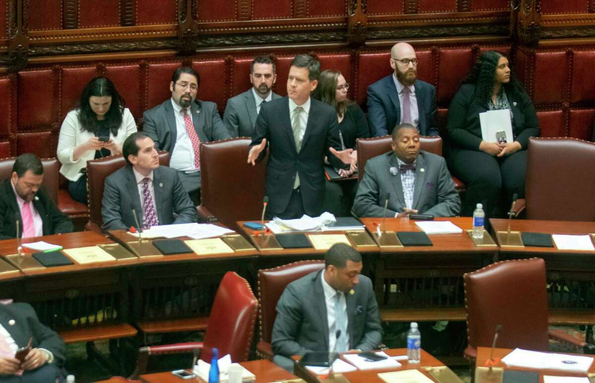 State Sen. Brad Hoylman, D-Manhattan, standing, discusses legislation Wednesday, May 8, 2019, at the Capitol in Albany, N.Y., that authorizes state tax officials to release, if requested, individual New York state tax returns to Congress. The bill now goes to the Democrat-led state Assembly after the Democrat-controlled Senate easily passed it.