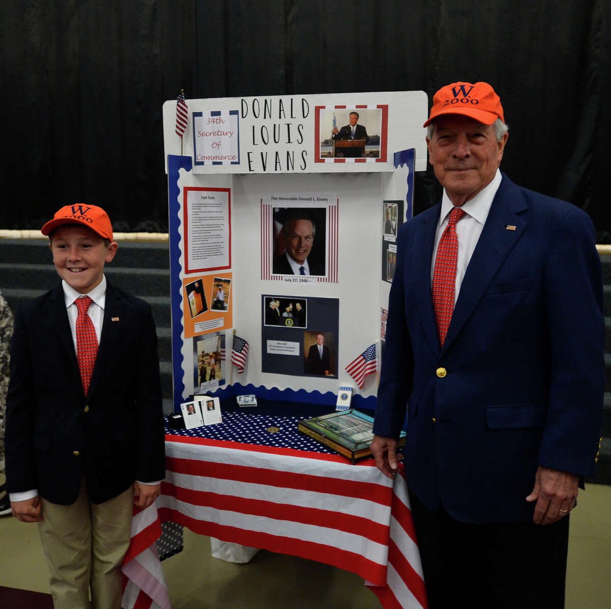 Hillander School student Mitchell Moon, left, portrayed Don Evans, right, for the school's Famous Americans project. Evans, Midland businessman and Commerce Department secretary under former President George W. Bush, is Mitchell's grandfather.