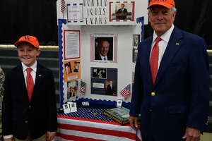 At left, Mitchell Moon acts as Don Evans for the Famous Americans project May 8, 2019 at the Hillander School. Pictured at right is Moon's grandfather, the actual Don Evans. James Durbin/Reporter-Telegram