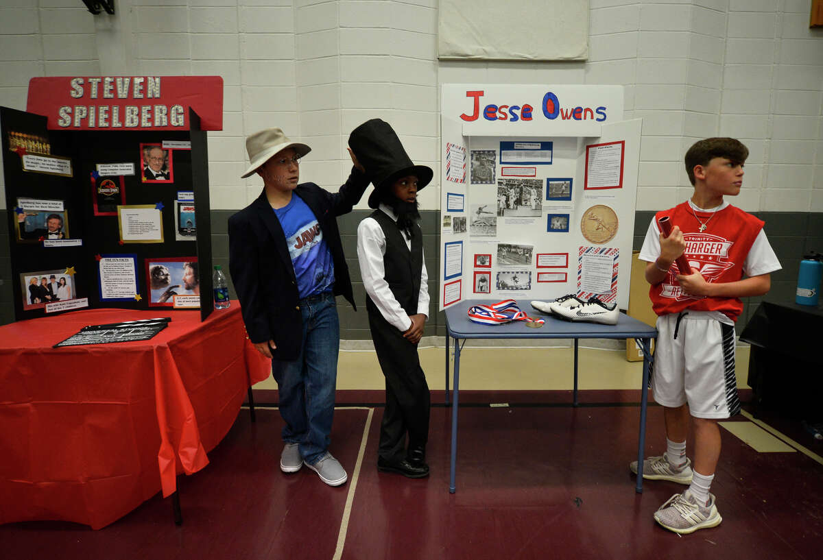 From left, Trucker Tranum, acting as Steven Spielberg, Nicholas Gibbons, acting as Abe Lincoln, and Jack Bowerman, acting as Jessie Owens, hang out during the Famous Americans project May 8, 2019 at the Hillander School. James Durbin/Reporter-Telegram