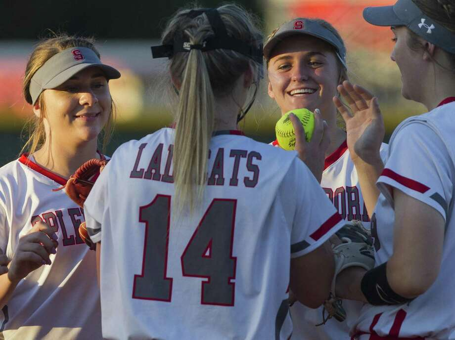 Splendora second baseman Shaelyn Sanders (4) and shortstop Kaicey Hagler (10) joke with starting pitcher Caleigh Millican (14) in the second inning of a Region III-4A high school softball bi-district playoff game, Friday, April 26, 2019, in Splendora. Photo: Jason Fochtman, Houston Chronicle / Staff Photographer / © 2019 Houston Chronicle