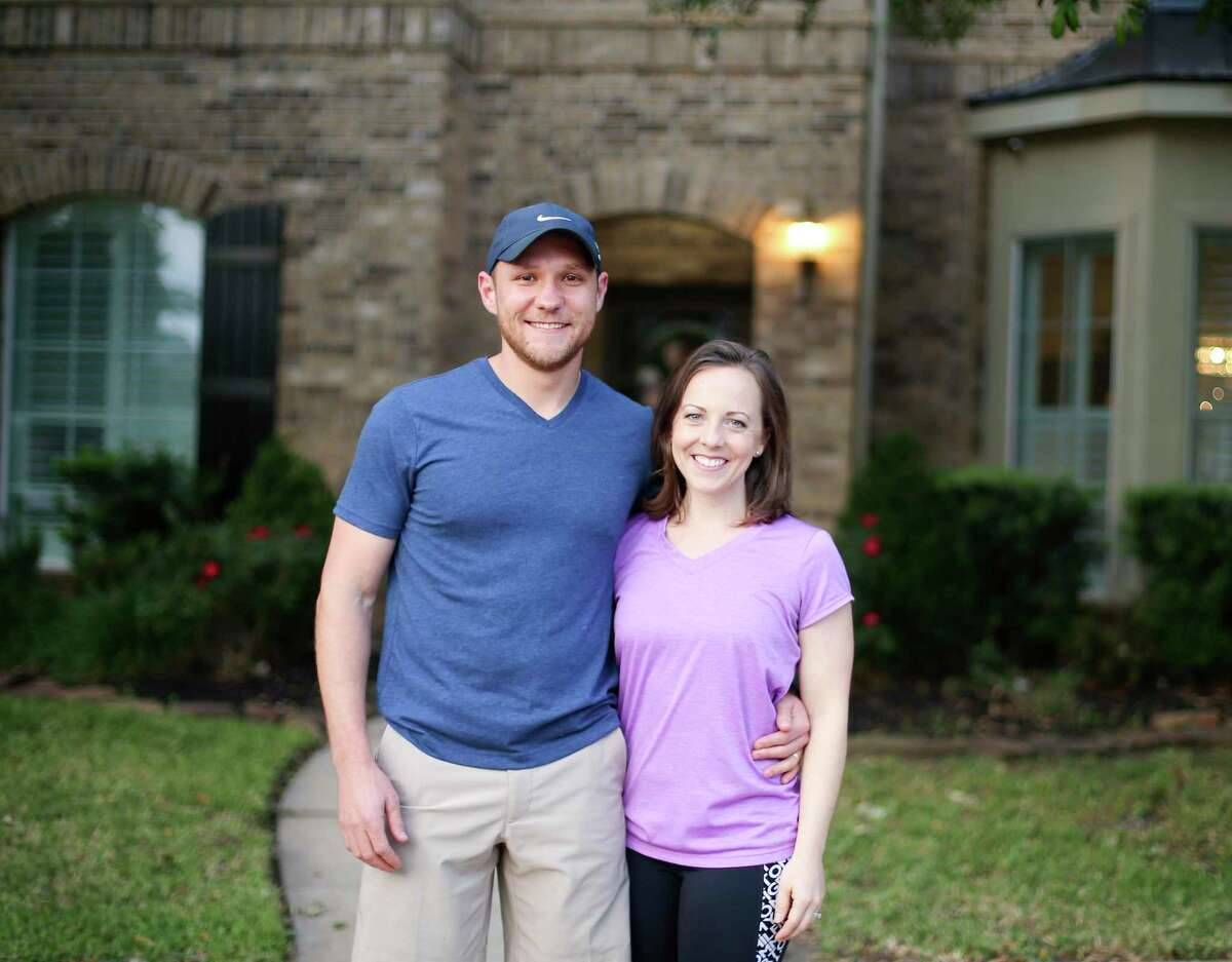 Amy and Adam Smith in their Cypress home on Tuesday, April 16, 2019. The two used Door, a Dallas-based discount brokerage to purchase and sell their homes.