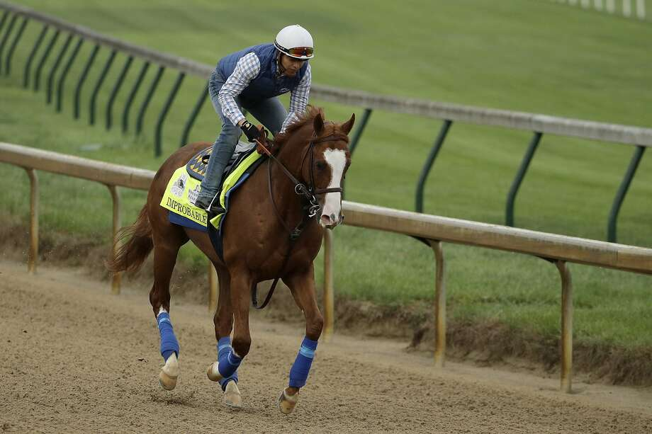 Kentucky Derby entrant Improbable runs during a workout at Churchill Downs Thursday, May 2, 2019, in Louisville, Ky. The 145th running of the Kentucky Derby is scheduled for Saturday, May 4. (AP Photo/Charlie Riedel) Photo: Charlie Riedel, Associated Press