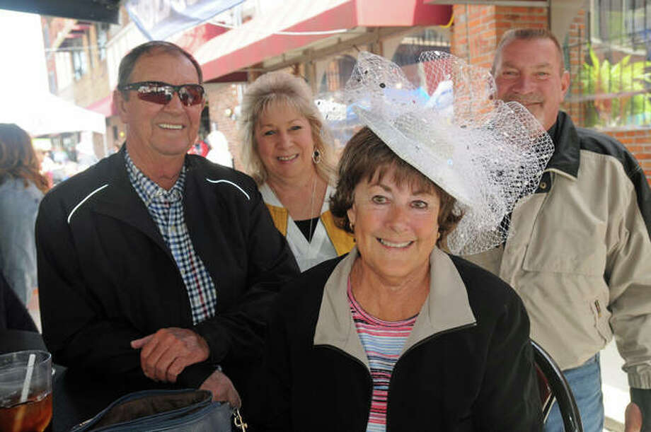 Nancy Brown of Alton is surrounded by her friends as she shows off her Derby hat at Mac's on Saturday.