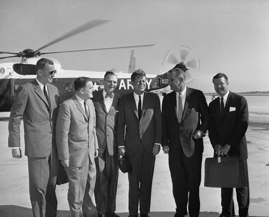 President John Kennedy poses with menber of his party before air takeoff on Sept. 11, 1962 at Andrews Air Force Base for an inspection tour of space centers. From left Budget Director David Bell, NASA administer James Webb, Rep. Albert Thomas, D-Texas, Kennedy; Vice President Lyndon Johnson, and Defense Secretary Robert McNamara. Photo: Associated Press