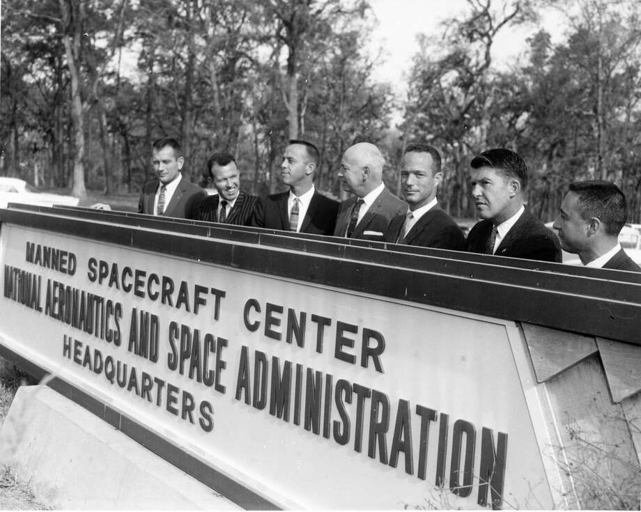 "Six of the seven NASA Mercury astronauts and Project Mercury director stand behind the sign for NASA's Manned Spacecraft Center temporary quarters in southeast Houston March 7, 1962. The astronauts met in Houston for the first time and attended an all-day briefing at the temporary offices at 3201 Brock. From left, Donald K. ""Deke"" Slayton, Leroy Gordon ""Gordo"" Cooper Jr., Alan Shepard, Project Mercury director Robert Gilruth, Scott Carpenter, Walter ""Wally"" Schirra Jr. and Virgil I. ""Gus"" Grissom. John Glenn is not in the photo. Photo: Staff File Photo"