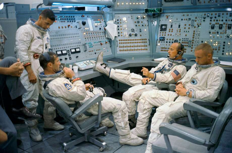 Gemini-11 prime and backup crews are pictured at the Gemini Mission Simulator at Cape Kennedy, Florida on Sept. 8, 1966.Left to right are astronauts William A. Anders, backup crew pilot; Richard F. Gordon Jr., prime crew pilot; Charles Conrad Jr. (foot on desk), prime crew command pilot; and Neil A. Armstrong, backup crew command pilot. (NASA)