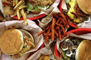 Fries, from left, are a solid value, and the chicken-fried steak sandwich is the best sandwich in the place — better than the bacon cheeseburger, mushroom Swiss burger and Fiesta Burger. Sweet potato fries and fried pickles are satisfying sides.