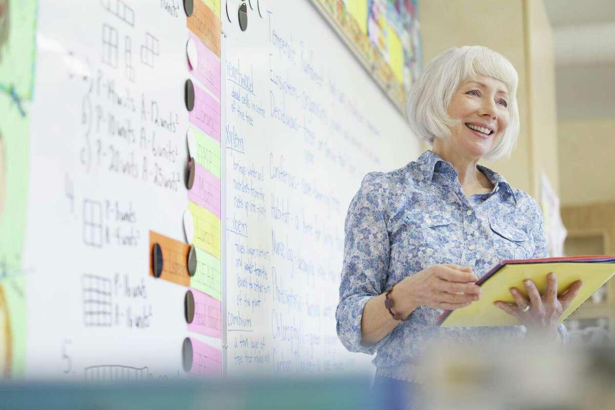 Elementary school teacher with white hair