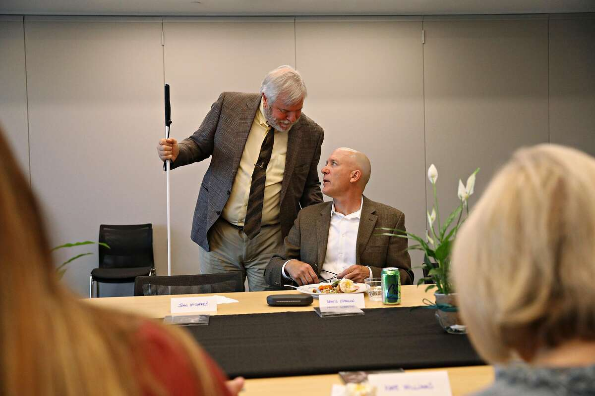 Bryan Bashin (l to r), LightHouse for the Blind and Visually Impaired executive director/ CEO, greets Dennis O'Hanlon, LightHouse for the Blind and Visually Impaired client and volunteer, during a donor event at LightHouse for the Blind and Visually Impaired on Friday, April 11, 2019 in San Francisco, Calif.