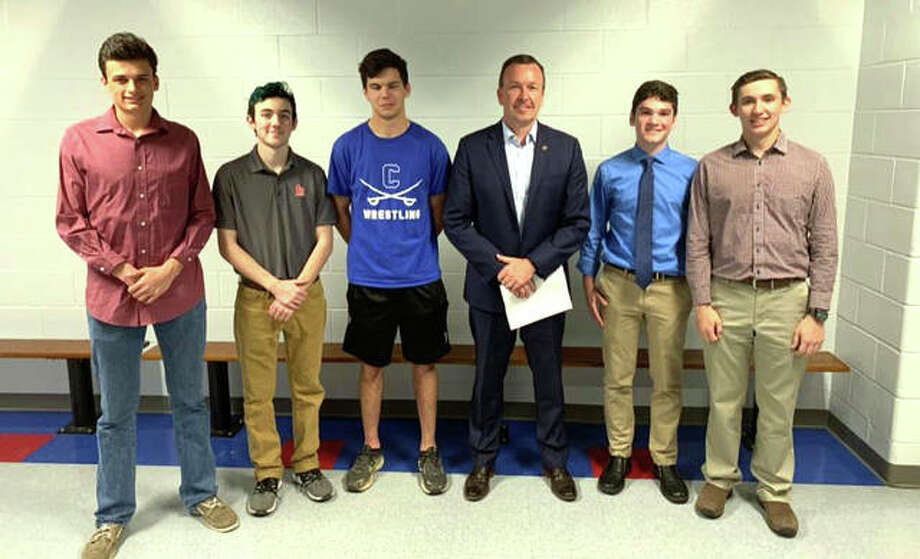 After meeting with a group of students from Carlinville High School, state Sen. Andy Manar, third from right, is proposing legislation that would make daylight saving time the year-round standard in Illinois. Photo: For The Telegraph