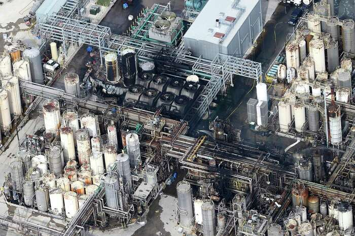 This aerial photo shows the KMCO chemical plant as firefighters spray water on a fire on Tuesday, April 2, 2019, in Crosby, Texas. Pilar Davis, a product manager with KMCO, says the fire initially ignited with isobutylene and was fueled by ethanol and ethyl acrylate. All three are chemicals and solvents used to make fuel additives at the plant.
