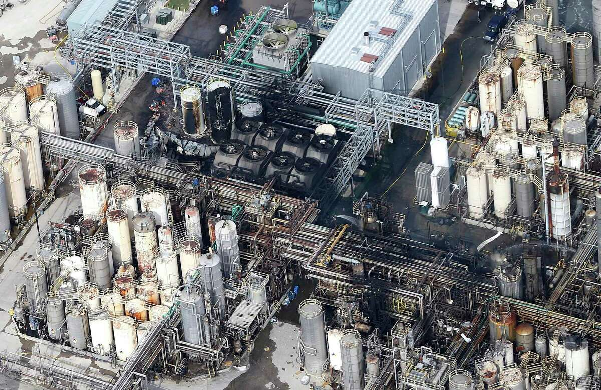 This aerial photo shows the KMCO chemical plant as firefighters spray water on a fire on Tuesday, April 2, 2019, in Crosby, Texas.