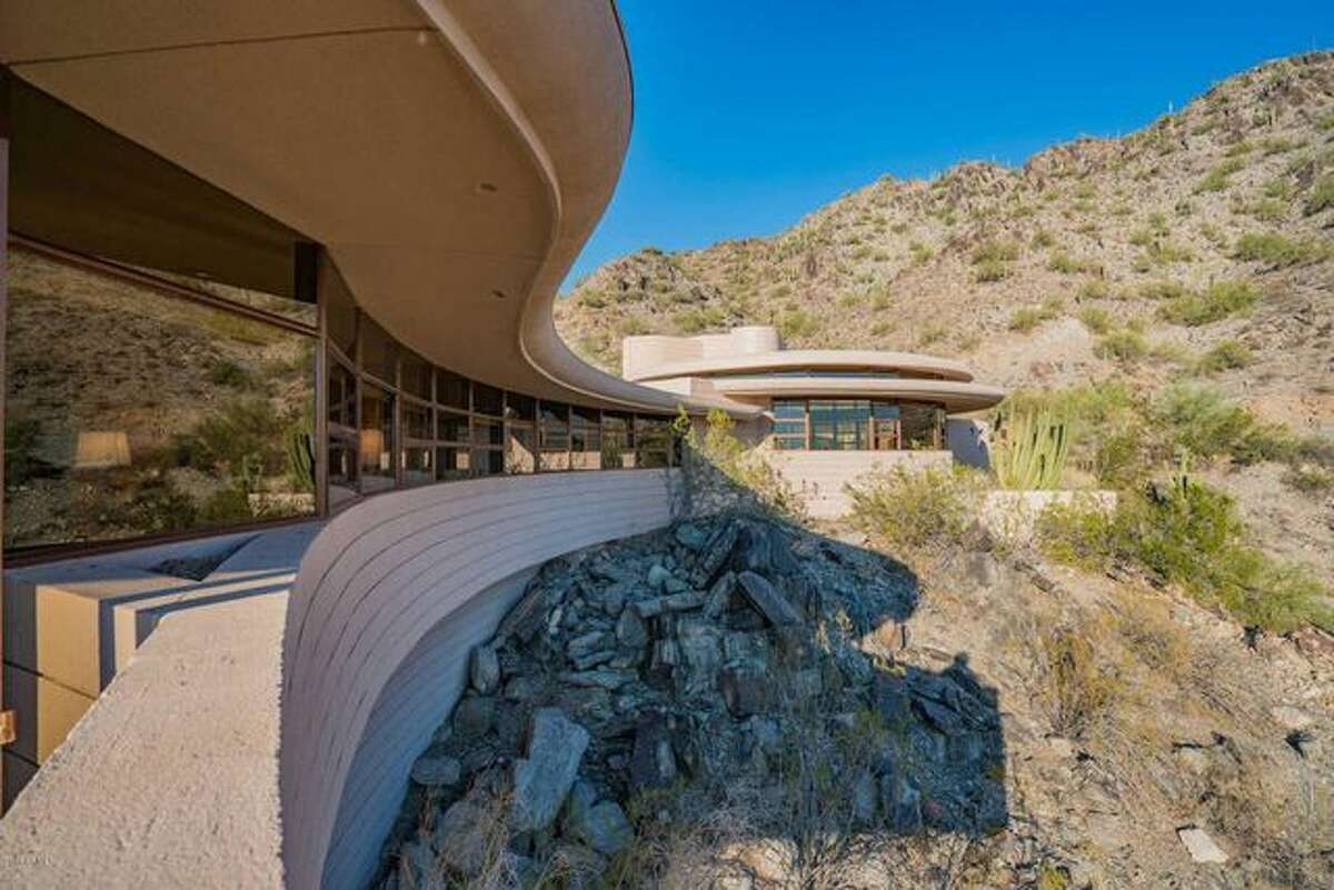 The curvy home is built atop a solid cement brick wall that has never failed. The final home Frank Lloyd Wright designed before death.