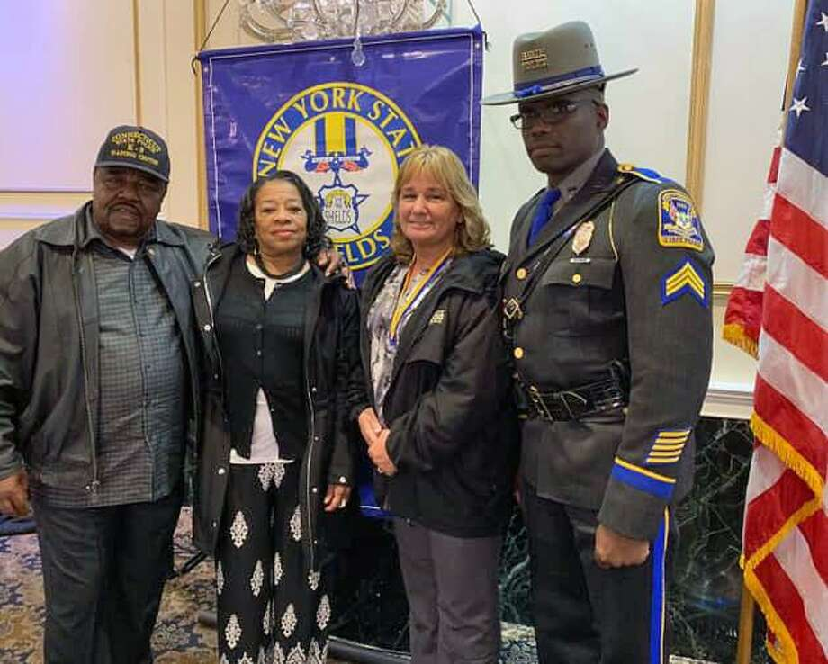 "Walter Greene's family was presented with the ""Shields Medal of Valor"" by the New York State Shields Executive Board. The recipients were Suzanne Greene, his wife; Ted Greene, his father; and Danet Gaithers, his stepmother. Photo: Contributed Photo / Connecticut State Police"