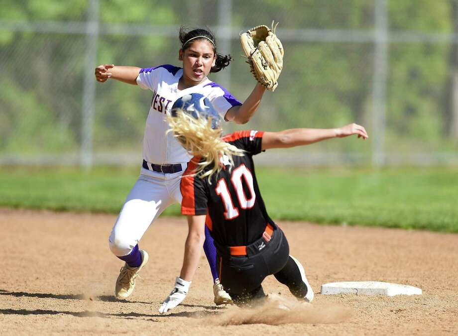 Westhill's Madelyn Bautista (1) tags out Stamford's Brycelin Stalteri (10) on a second inning steal in a girls softball game at Westhill High School on May 8, 2019 in Stamford, Connecticut. Stamford defeated Westhill 6-4 in eight innings. Photo: Matthew Brown / Hearst Connecticut Media / Stamford Advocate