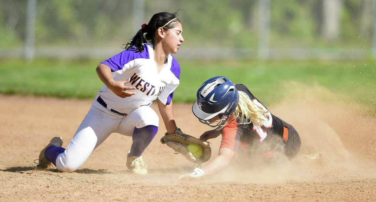 Westhill's Madelyn Bautista (1) tags out Stamford's Brycelin Stalteri (10) on a second inning steal in a girls softball game at Westhill High School on May 8, 2019 in Stamford, Connecticut. Stamford defeated Westhill 6-4 in eight innings.