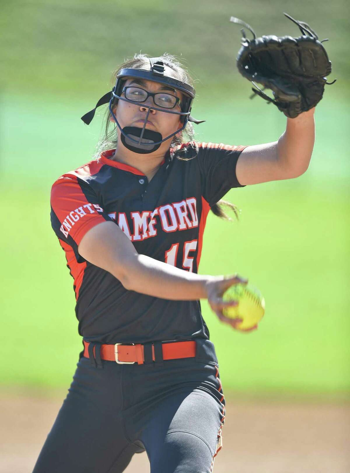 Stamford pitcher Kim Saunders (15) makes her delivery in the first inning against Westhill in a girls softball game at Westhill High School on May 8, 2019 in Stamford, Connecticut. Stamford defeated Westhill 6-4 in eight innings.