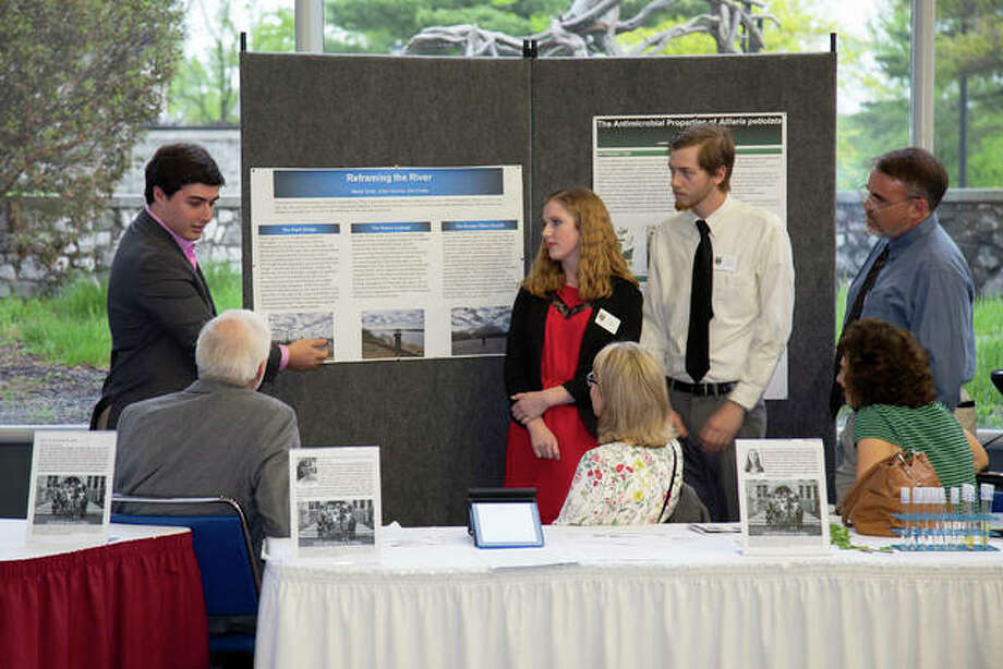 Lewis and Clark Honors College student Ethan Kercher, far left, discusses his group project on river attitudes with his classmates and expo guests. Photo: Louise Jett, L&C Media Services
