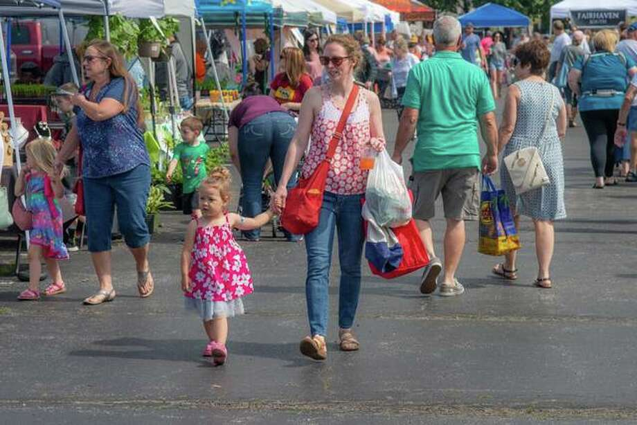 Crowds browse the Alton Farmers Market last year