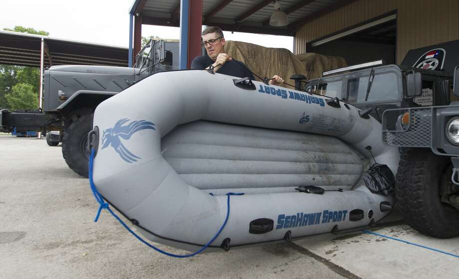 Cpt. Buck Clendennen with Montgomery County Precinct 4 ConstableÕs Office moves an inflatable raft to be washed out after being used for water rescues the night before, Wednesday, May 8, 2019, in New Caney. Photo: Jason Fochtman/Staff Photographer