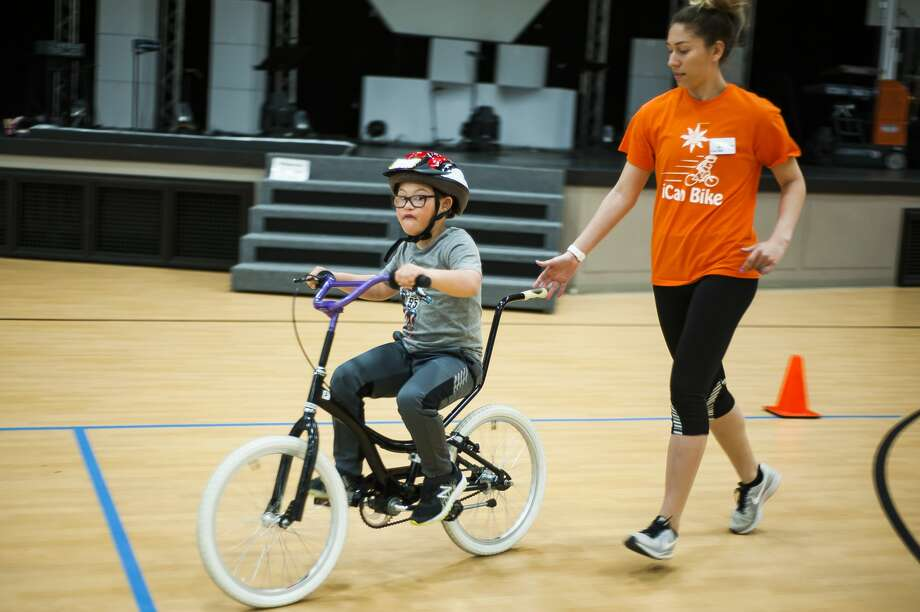 Jayson Brooks of Coleman, 10, mimics the sound of an engine while riding a bicycle for the first time after participating in the iCan Bike Camp, hosted by The Arc of Midland, on Wednesday, May 8, 2019 at Midland Evangelical Free Church. (Katy Kildee/kkildee@mdn.net) Photo: (Katy Kildee/kkildee@mdn.net)