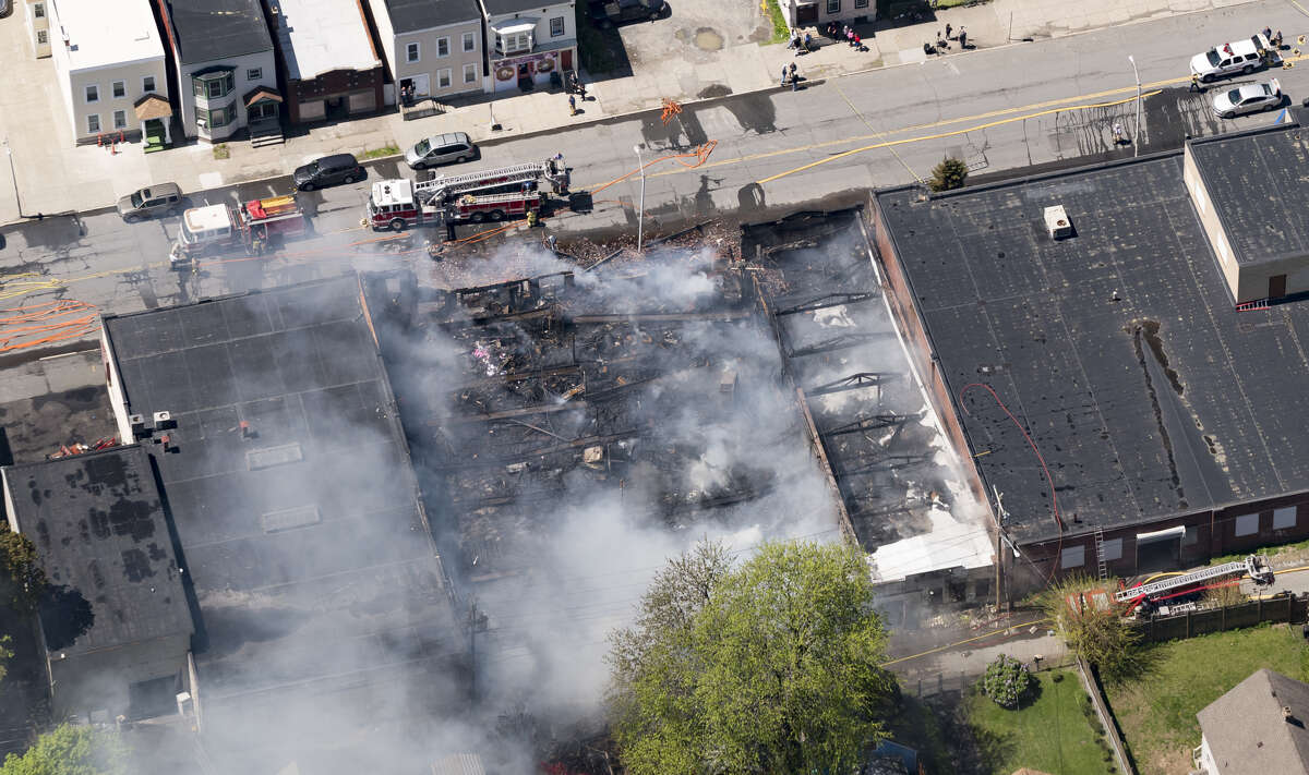 An aerial view shows the damage enacted after a massive blaze on 5th Avenue consumed the Alpha Lanes bowling alley on Wednesday, May 8, 2019, in Troy, N.Y.