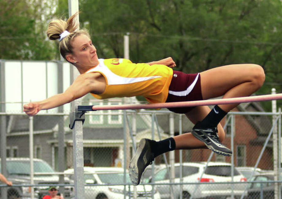 EA-WR sophomore Hannah Sechrest clears the bar at 5 feet, 3 inches to set a school record in the high jump Monday at the Springfield Lanphier Class 2A Sectional. Sechrest advances to state in the event. Photo: Greg Shashack / The Telegraph