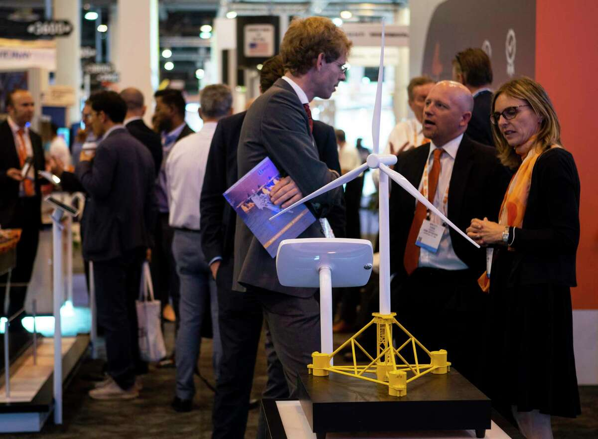 """An offshore wind turbine system design is on display at the SBM Offshore booth during the annual Offshore Technology Conference inside Houston's NRG Center, Tuesday, May 7, 2019. OTC, which usually takes place every May at NRG, was canceled this year. It has booked its 2021 conference Aug. 16-19, 2021, """"due to the ongoing challenges presented by COVID-19,"""" organizers said last month."""