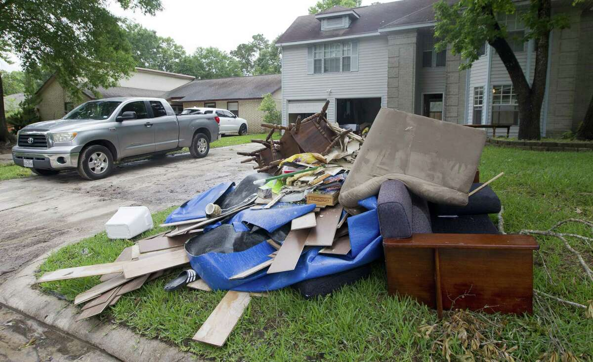 Debris is seen at the front a home in the Sherwood Trail subdivision, Wednesday, May 8, 2019, in Kingwood. Heavy rain battered parts of southeast Texas prompting flash flood warnings, power outages and calls for water rescues.
