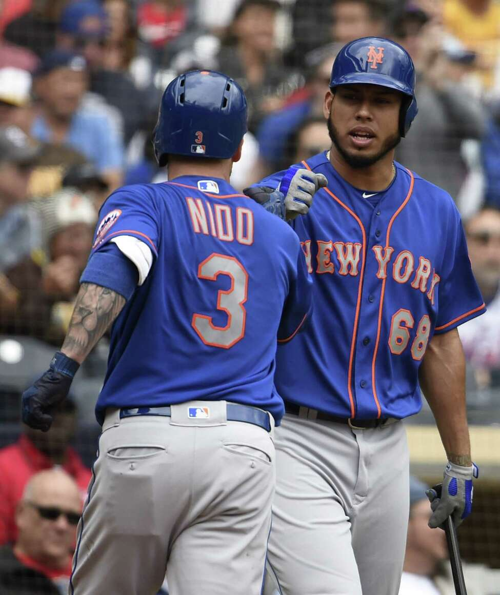 SAN DIEGO, CA - MAY 8: Tomas Nido #3 of the New York Mets is congratulated by Wilmer Font #68 after hitting a solo home run during the second inning of a baseball game against the San Diego Padres at Petco Park May 8, 2019 in San Diego, California. (Photo by Denis Poroy/Getty Images)