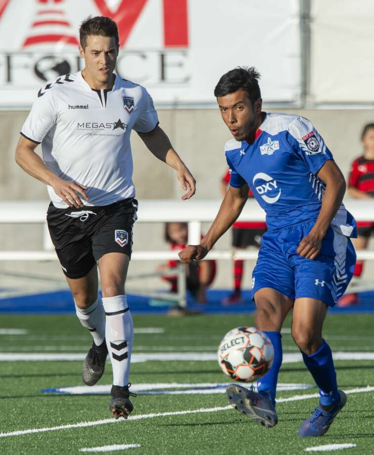 Sockers' Miguel Salazar looks to pass 05/08/19 as a FC Denver player gets close at Grande Communications Stadium. Tim Fischer/Reporter-Telegram Photo: Tim Fischer/Midland Reporter-Telegram
