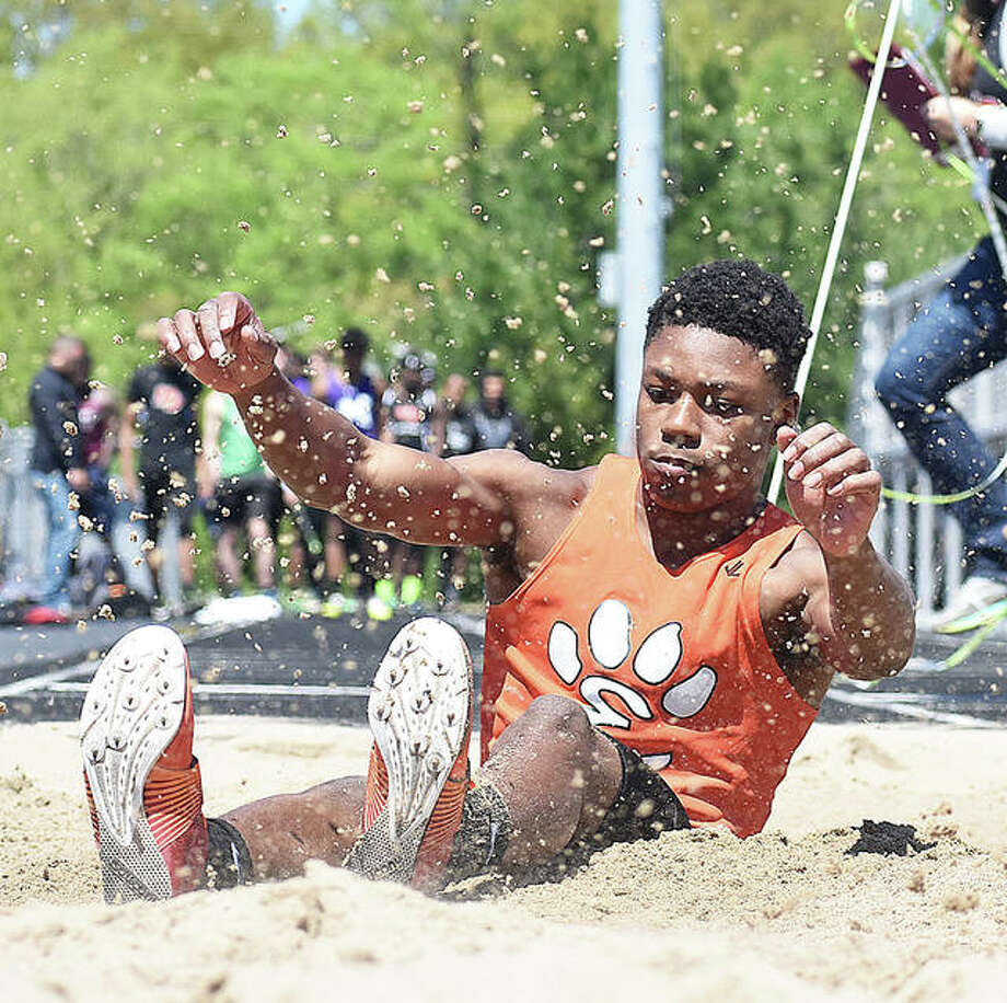 Edwardsville's Kenyon Johnson completes a long jump during the Triad Invitational earlier in the season in Troy. Johnson broke the school record Wednesday in Collinsville. Photo: Matt Kamp/The Intelligencer
